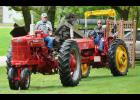 Tim Lickteig (left) of Buck Grove and Danny Mickelson move tractors on the farm.