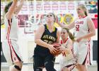 HCHS senior Jordyn Moser (34) goes for the steal against Atlantic's Catherine Leonard during Tuesday night's Hawkeye Ten basketball game as Emma Ahrenholtz (right) and Taylor Frederick also defend for the Cyclones, who won the game 57-44.