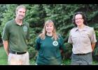 Naturalist Christina Roelofs will now also serve half-time duties with the Iowa DNR.  Roelofs (center) is pictured with Shelby County Conservation Board Director Nick Preston and Michelle Reinig, park manager, Prairie Rose State Park.