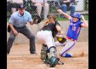 AHSTW freshman Madison Heiny (15) slides around the tag attempt of IKM-Manning catcher Zoey Melton to score a first-inning run on Wednesday night. The Lady Vikes went on to win the game 12-1. (Photos by Bob Bjoin)